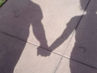Hand holding shadow